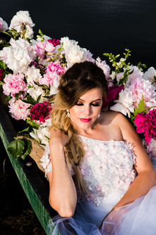 Bride in Canoe with Peonies. Styled Shoots Across America.