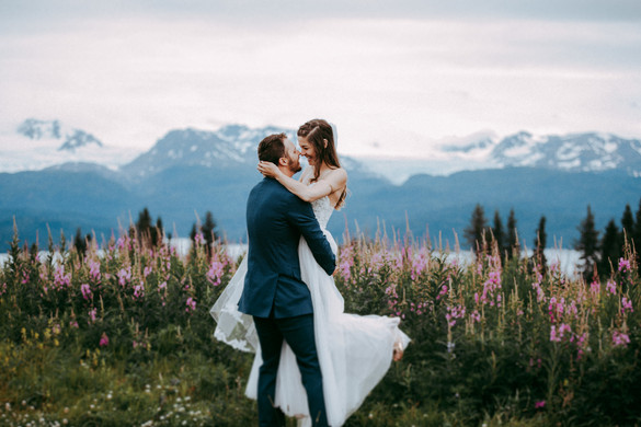 Mid July - Bride and Groom with fireweed and Mountains