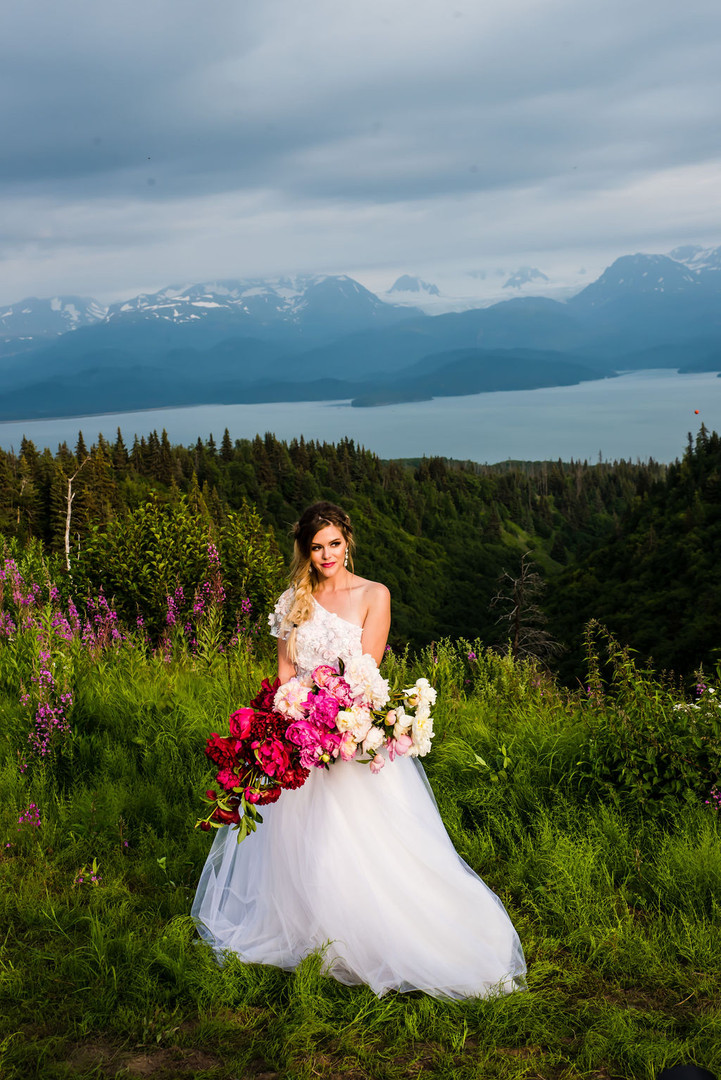 Bride overlooking Kachemak Bay with Intrigue Designs Bouquet