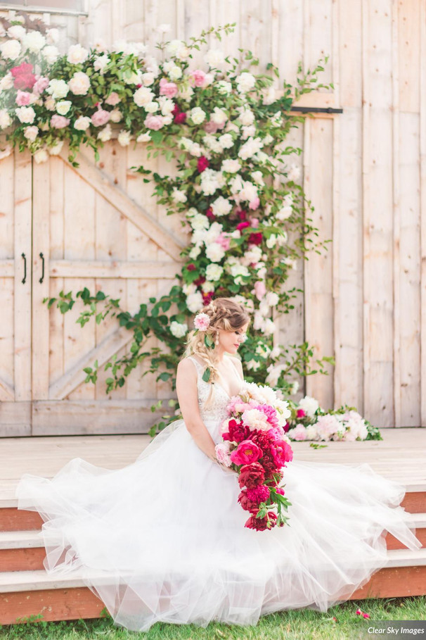 Bride with Peony Bouquet and Arch by Intrigue Designs