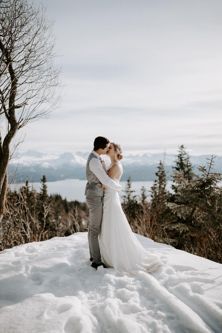February - Winter wedding, Bride and Groom at Diamond Willow point overlooking Kachemak Bay