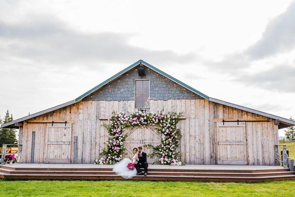 Heritage Barn - Bride and Groom with Intrigue Designs Peony Arch