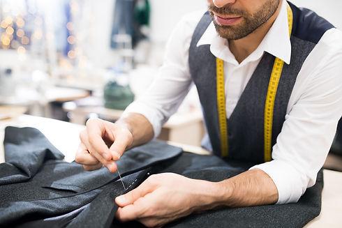 tailor-sewing-jacket-closeup-ALYJDBW.JPG
