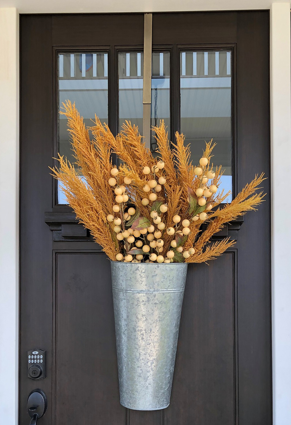 Jennifer Janeway Designs - Ornamental grasses and mini pumpkins fill this galvanized wall pocket