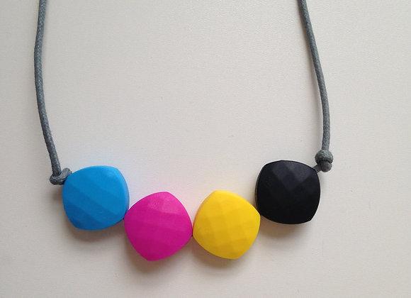 Sky blue, fuchsia, yellow & black (CMYK) quadrate bead teething necklace