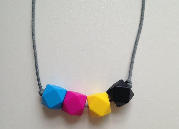 Sky blue, fuchsia, yellow & black (CMYK) hexagon bead teething necklace