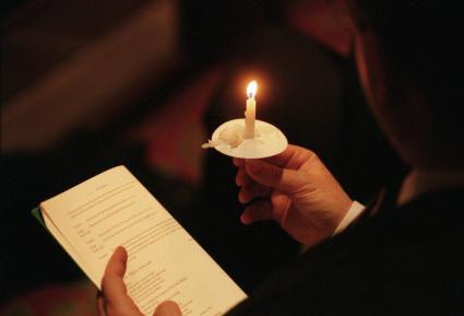 255222-425x289-Worshiper_Candle.jpg