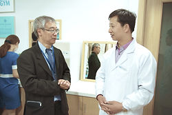 Dr Goh Seng Heng talking to another Doctor