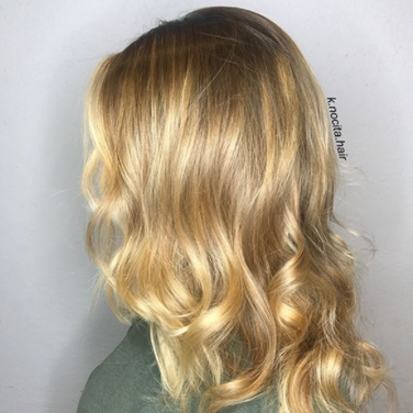 We did a soft golden balayage and curls to create this real life Goldielocks look