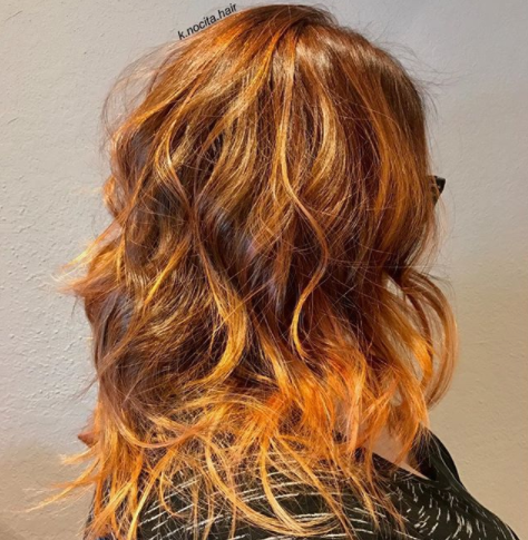 Brightened this client's look up with orange an strawberry blonde balayage!