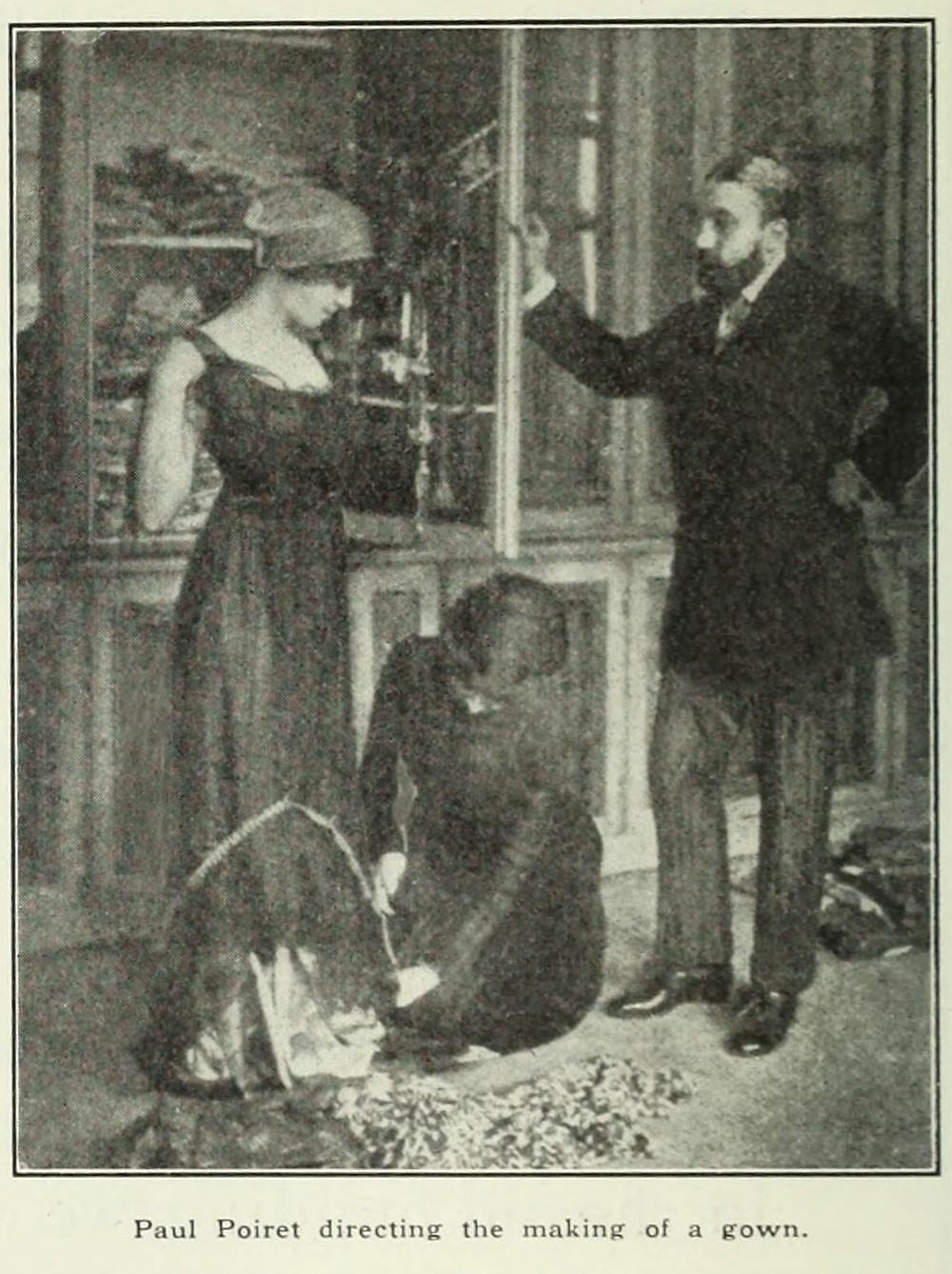 Poiret conducting a fitting in 1911.
