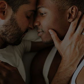 gay-couple-cuddling-in-bed-KAWZXLE_edite