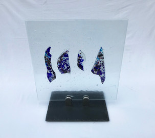 Glass, slate, chrome.  40cm x 40cm.