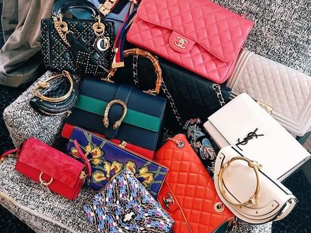Tipson choosing a designer handbag.