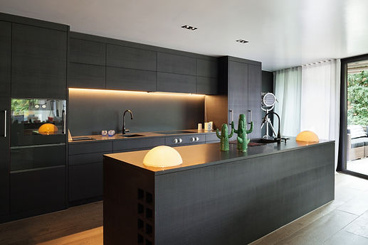 Modern kitchen with black furniture and