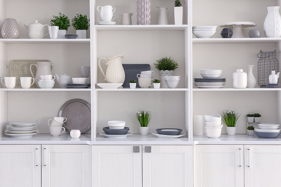 Open cupboard with clean dishes in kitch