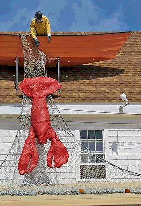 Sculpture of fisherman in boat with giant lobster