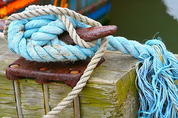 Blue and white ropes tied to a mooring cleat at a Wellfleet marina