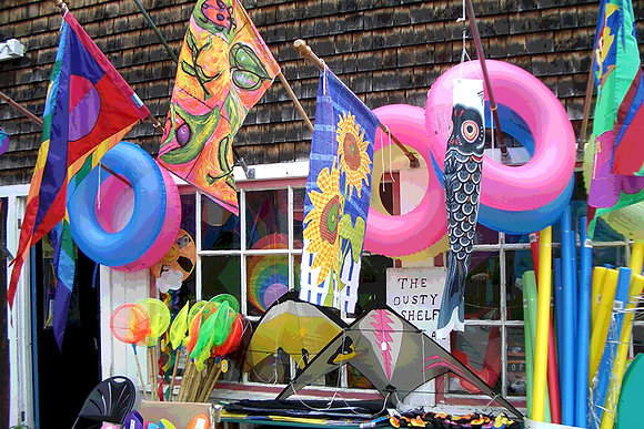 Flags and water toys displayed outside a shop