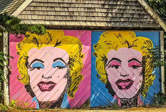 Portraits of Marilyn Monroe on the side of a garage