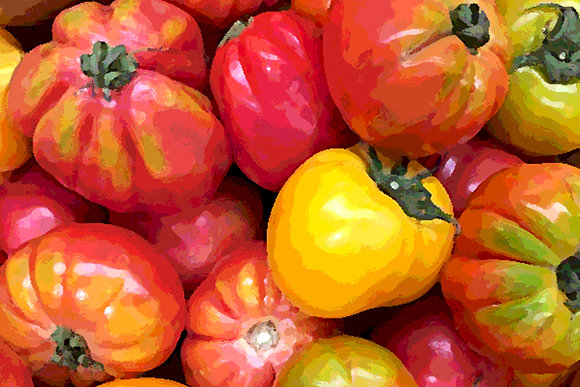 Close-up image of ripe orange and yellow heirloom tomatoes