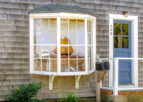 Model ship in a bay window