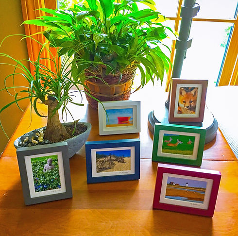 Arrangement of Photo-Graphic Miniatures on an end table