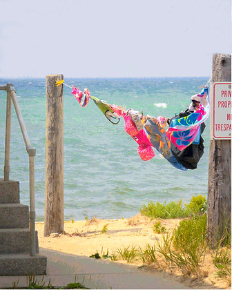 Swimsuits and towels on a clothesline, with Cape Cod Bay in background