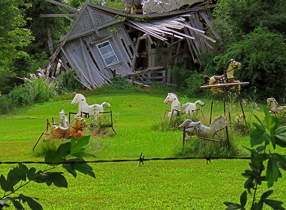 Dilapidated barn and spring rocking horses