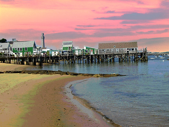 Pink sunrise behind Captain Jack's Wharf, with Cape Cod Bay shoreline