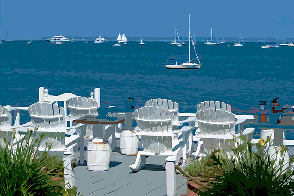 White Adirondack chairs on deck overlooking sailboats on Cape Cod Bay