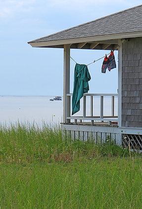 Laundry on a clothesline beside a bay