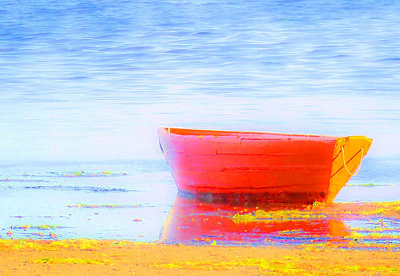 Red rowboat at low tide