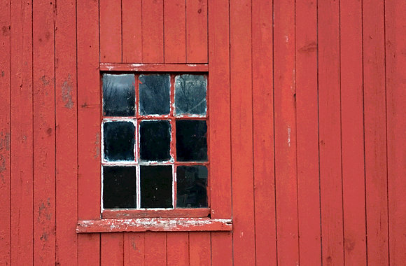 Detail of red barn window