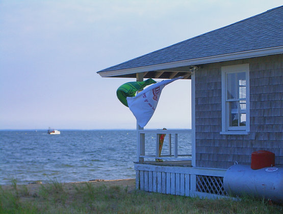 House on the bay in Wellfleet, Mass., with towels blowing in the breeze