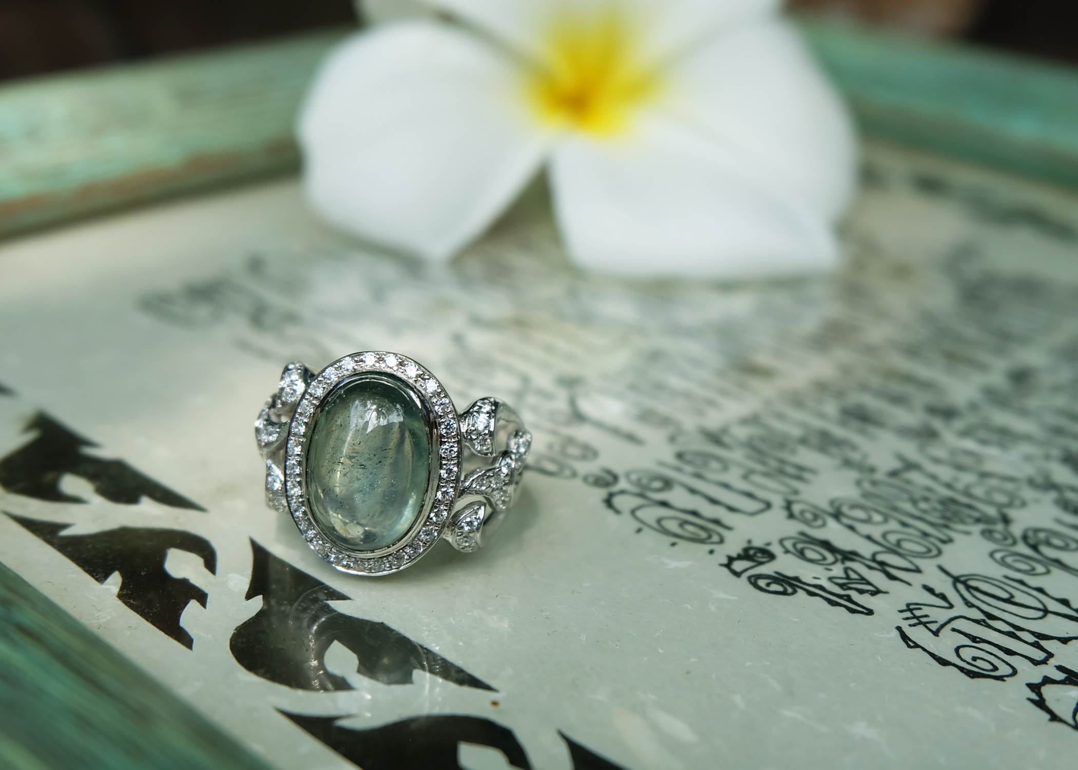 Emerald with cubic zirconia