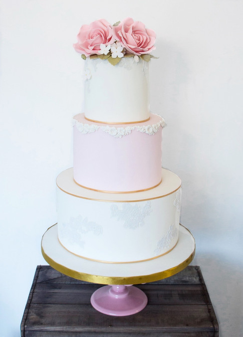 Wedding cake with handmade sugar flowers and roses.