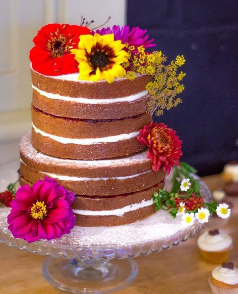 Naked cake with edible natural flowers.