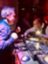 Photo Monti at DJ booth with Godoy.jpg