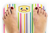 Feet on bathroom scale with sad cute fac