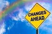Changes Ahead Sign With Rainbow Sky And