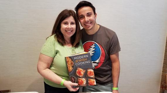 Bonnie + son with cookbook.jpg