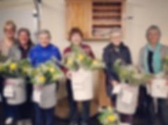 Zonta Members prepare roses for Rose Day