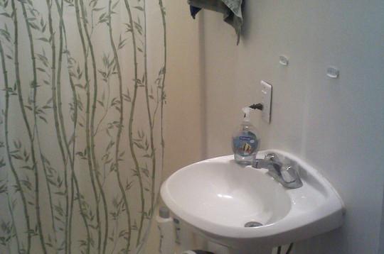 full bathroom with sunken tub