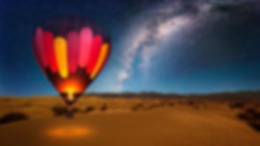 Hot air balloon in the desert at night -
