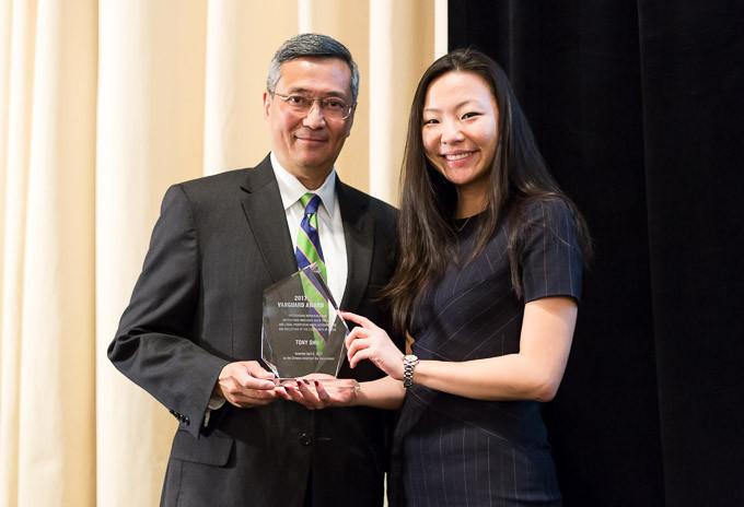 Yankun Guo presents the Vanguard Award to Tony Shu. Photo courtesy of Tony Shu.