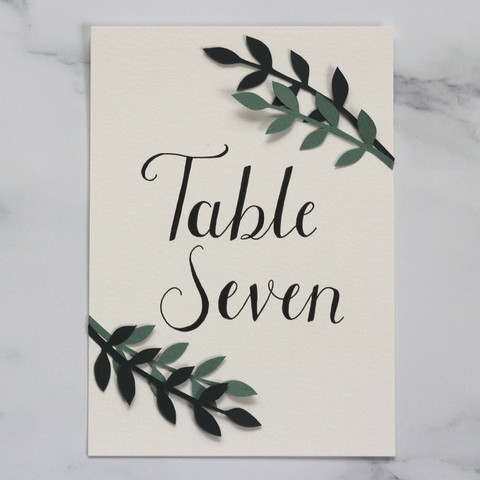 Hand Lettered Table Name with Papercut Leaves