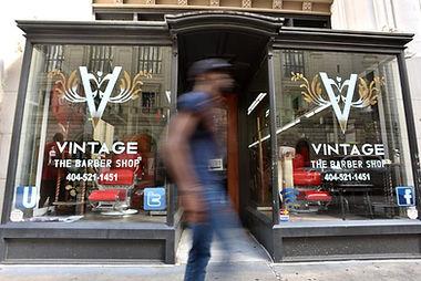 Vintage the Barbershop Atlanta. Man walking by.