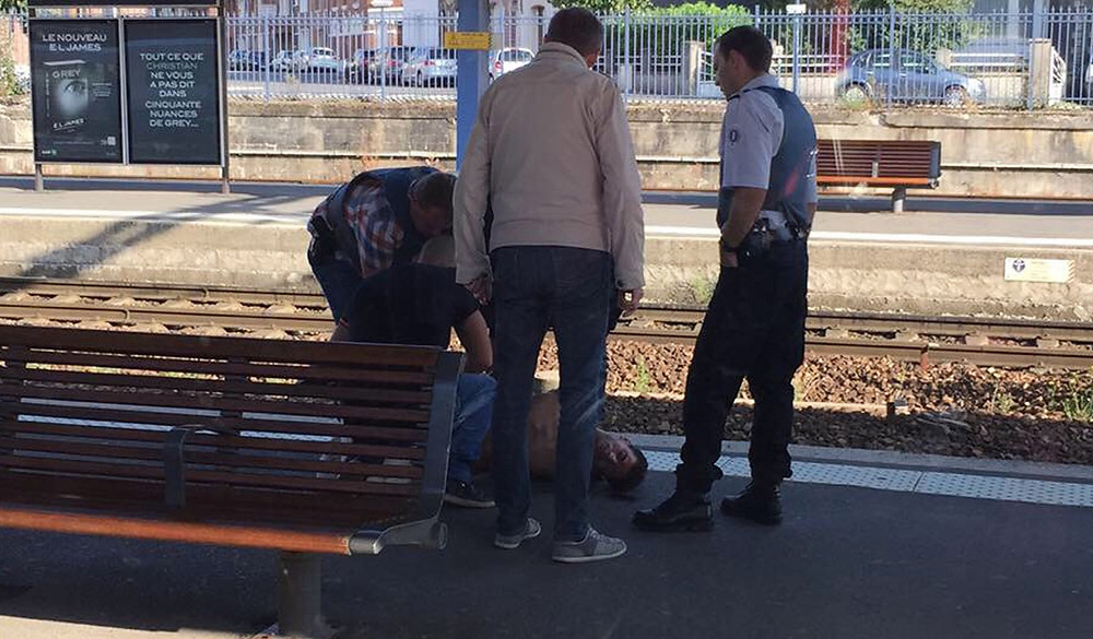 Ayoub El Khazzani unconscious and restrained on platform of Arras Station attempted terrorist attack Thalys high speed train Amsterdam to Paris boarded in Belgium