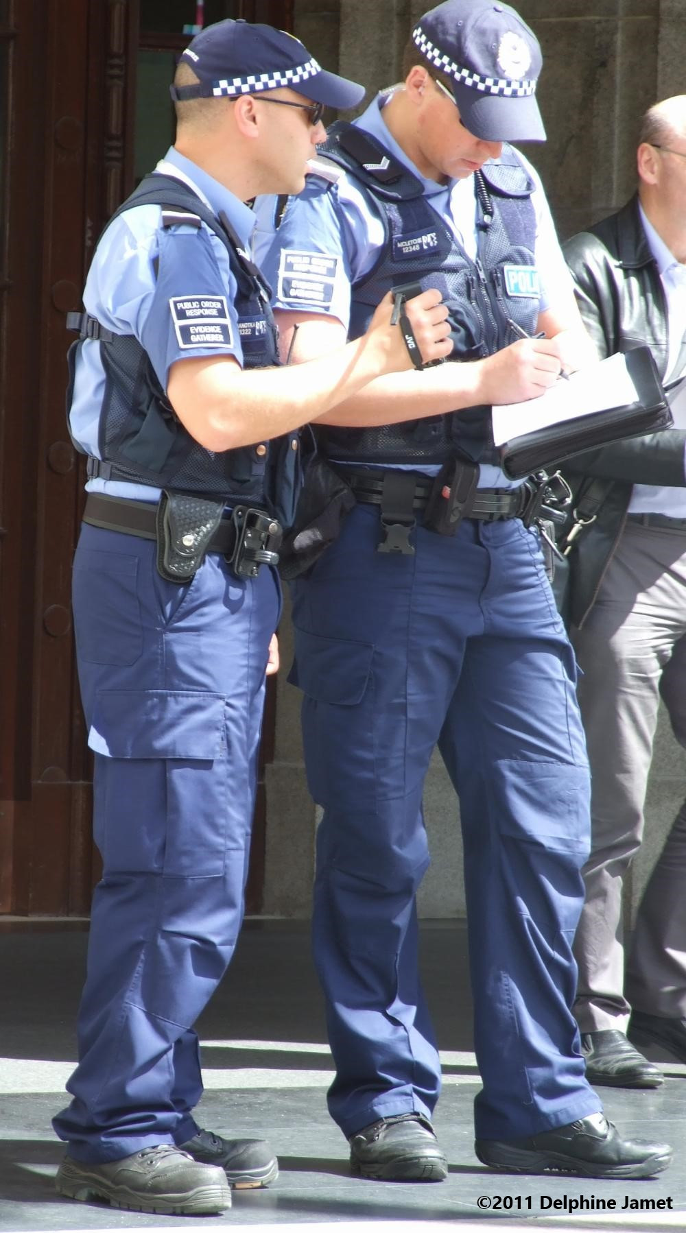 Western Australia police officers gather intelligence and video evidence of protestors at the 2011 CHOGM protest event in Forrest Chase
